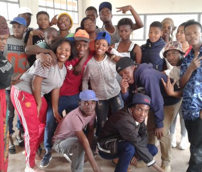 "Badirile Secondary School learners posing for a picture with their artist facilitator, ""Kay-Kay Sambo"". The picture was taken a day before the performance which took place in Soweto."